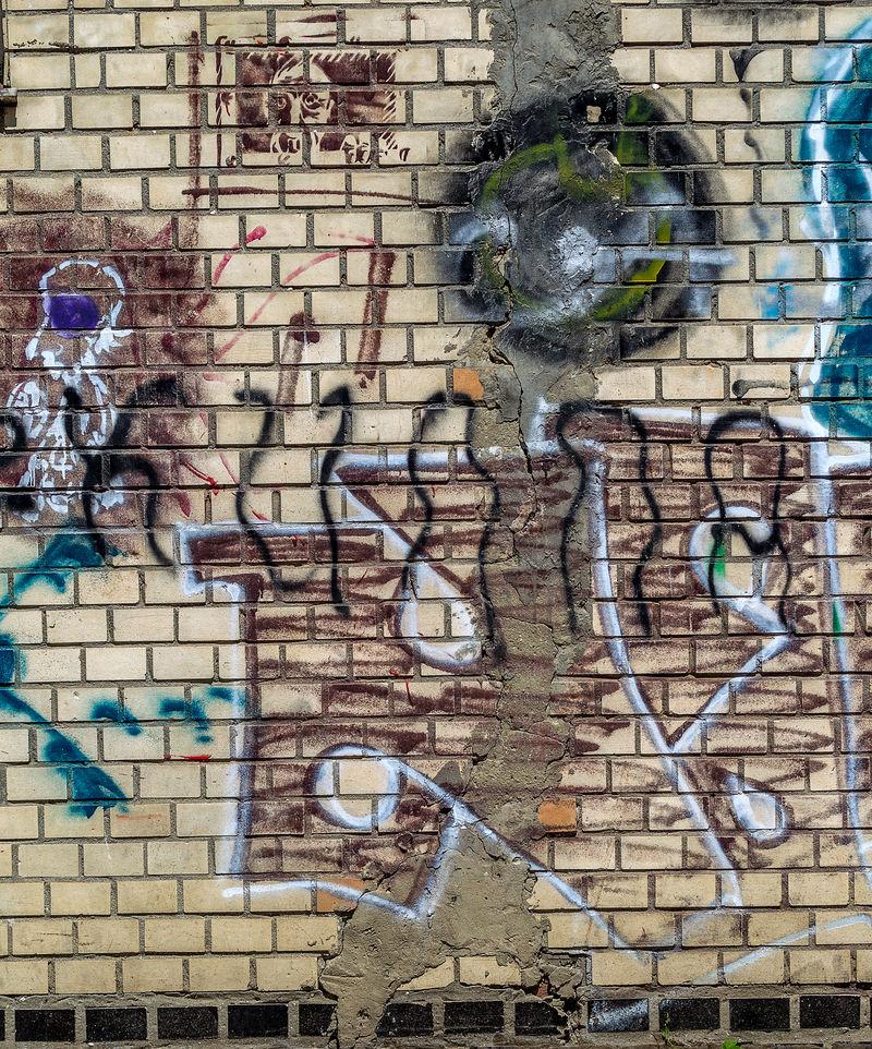 美丽的街头艺术涂鸦。抽象创意在城市的墙上画出时尚的色彩。城市当代文化