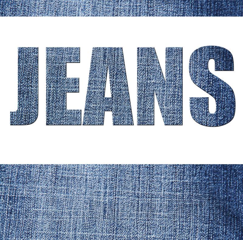 """牛仔裤背景上的""""牛仔裤""""字样"""