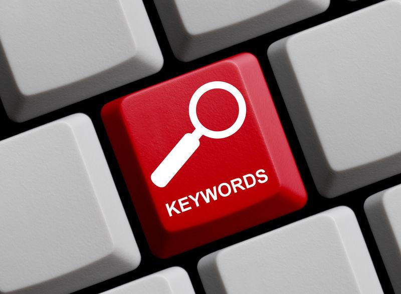 红色电脑键盘-带放大镜符号-显示关键字