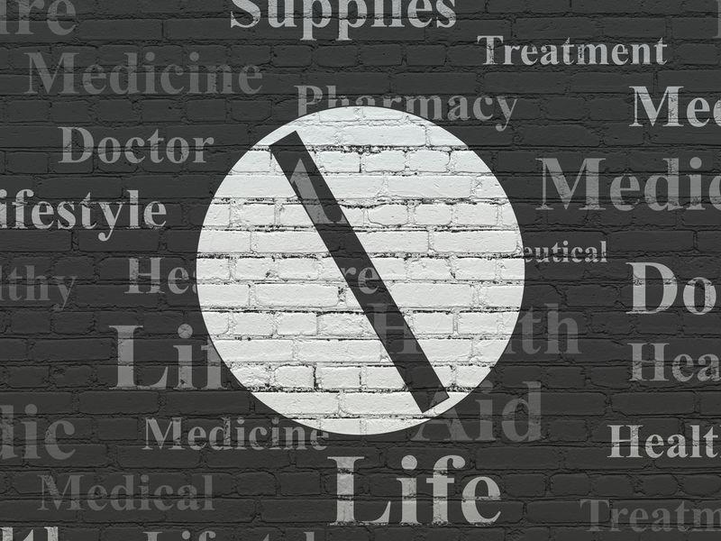 医疗理念:药丸贴墙背景