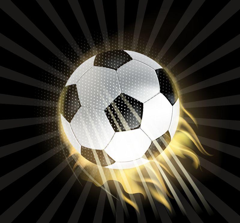 足球在火中孤立在黑色背景上