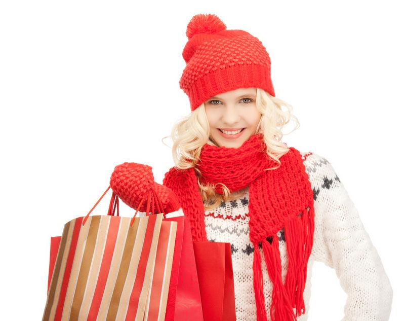 带着购物袋的年轻女孩的照片