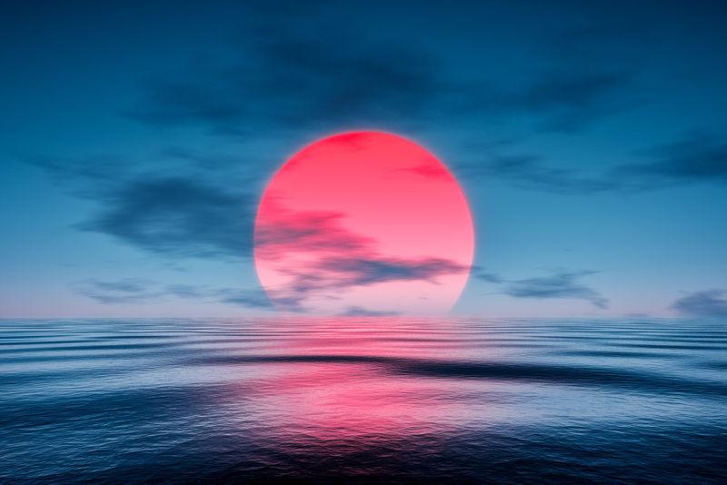 蓝色海面上的红色日落