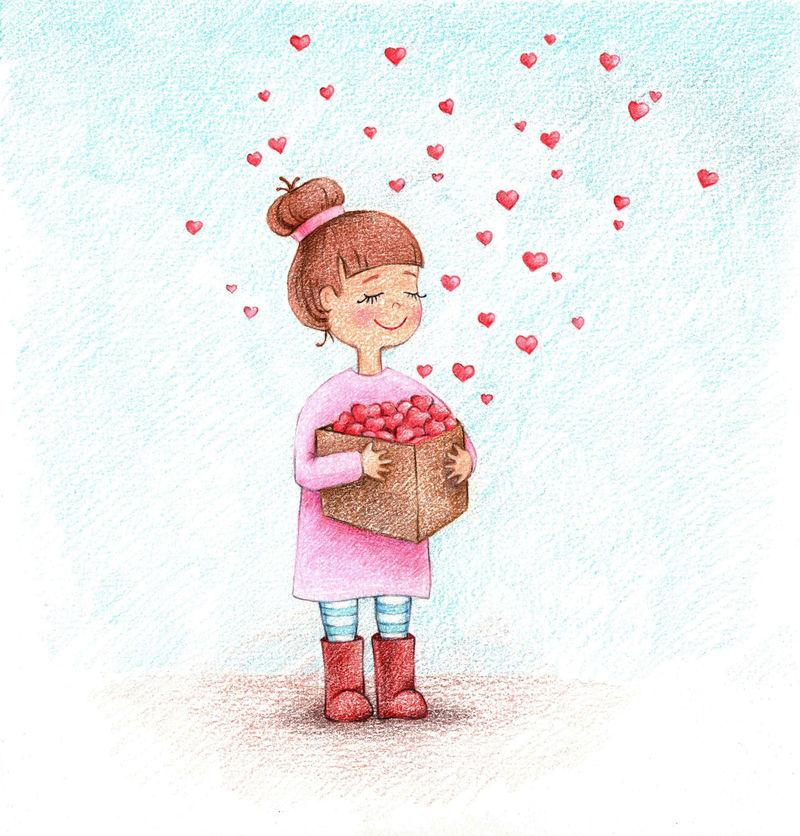 孩子的照片,女孩拿着铅笔盒的心。