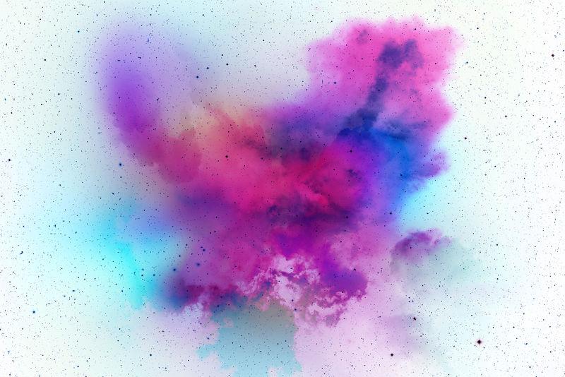 彩色背景粉彩粉爆炸-彩色粉尘飞溅在白色背景上