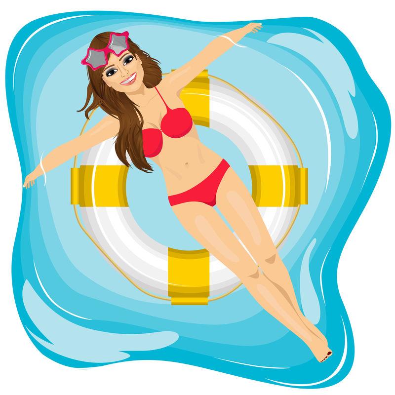 漂亮的年轻女孩在游泳池里放松,漂浮在充气圈上