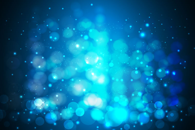 闪光抽象波克蓝颜色圣诞灯模糊在黑色背景上