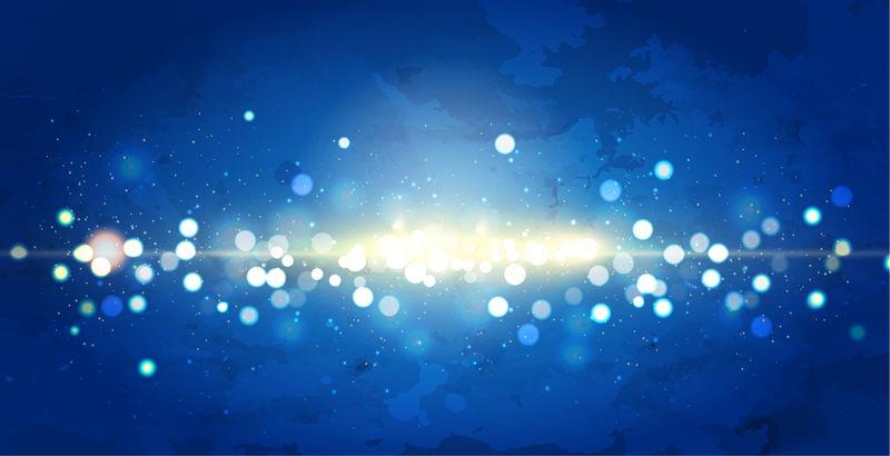蓝色闪光模糊效果和点光源从蓝色背景的侧面落下