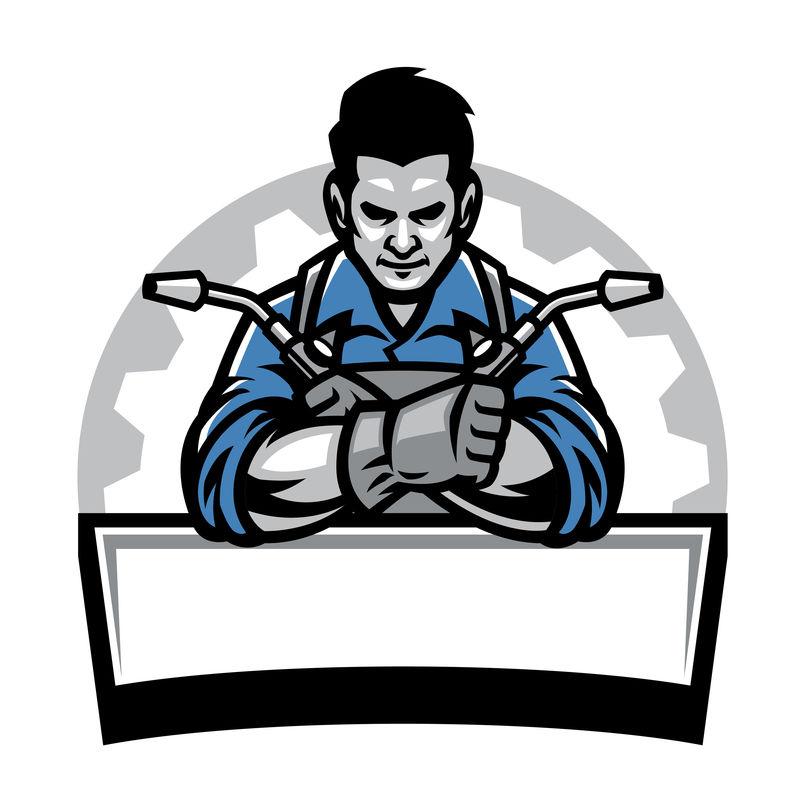 带焊接工具徽章的焊工