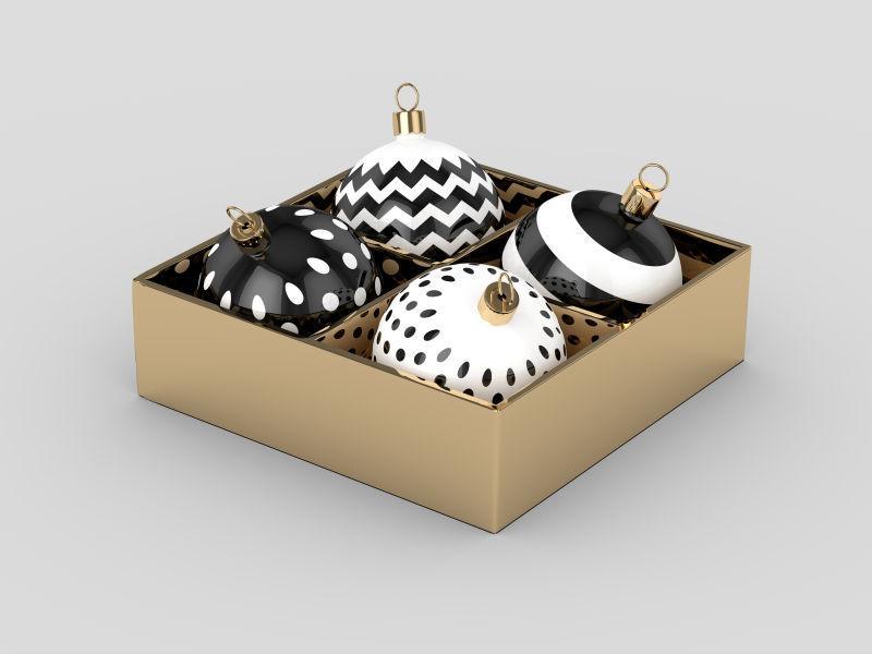 灰色背景下盒子里的圣诞精美装饰